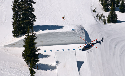helicopter filming skiier in snow