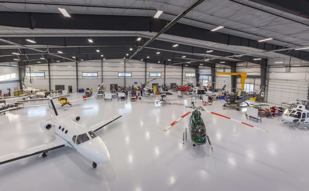 Hillsboro Aviation Comprehensive Services Aircraft Charter Management Helicopters Hanger With Planes And