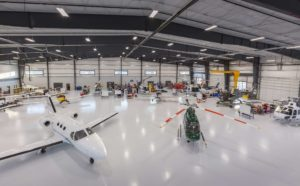 hanger with planes and helicopters
