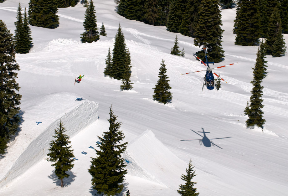 helicopter filming skiier