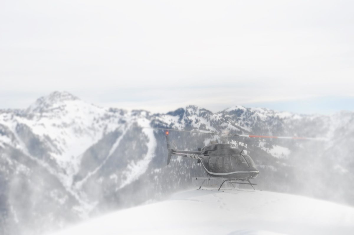 helicopter landing in snowy mountains