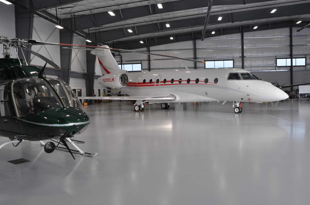 airplane and helicopter in hanger