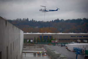 helicopter dropping boxes at a facility