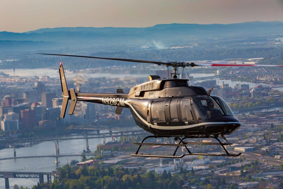 bell 407 flying over portland