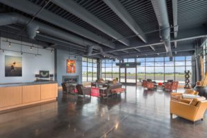 hillsboro aviation fbo interior with windows and seating area