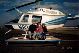 family in front of helicopter