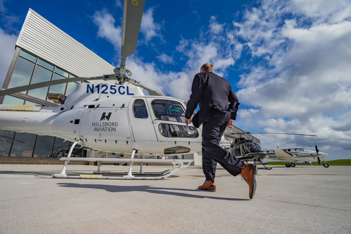 man walking to airbus h125 helicopter