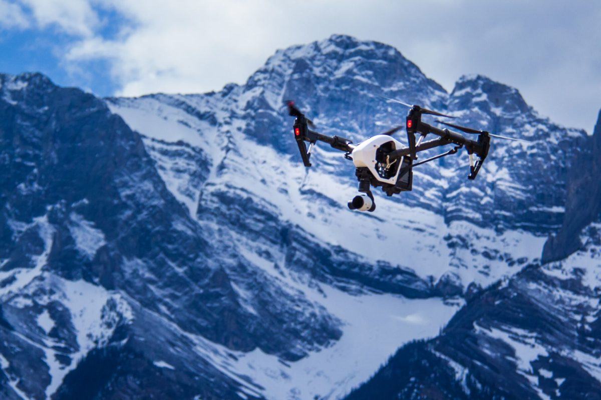 drone flying over snowy mountain